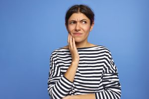 Frowning woman thinking about rare oral health problems