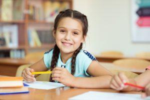 Smiling girl at school after visiting children's dentist