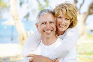 couple smiling thanks to the dentist colorado springs loves