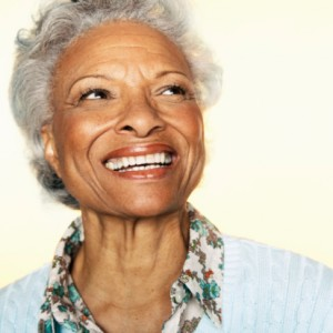 senior woman with a beautiful complete smile thanks to the implant retained dentures colorado springs residents rely on