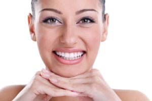 Woman with beautiful teeth after visiting cosmetic dentist
