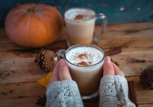 holding pumpkin spice latte