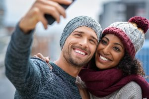 smiling couple dressed in winter clothes